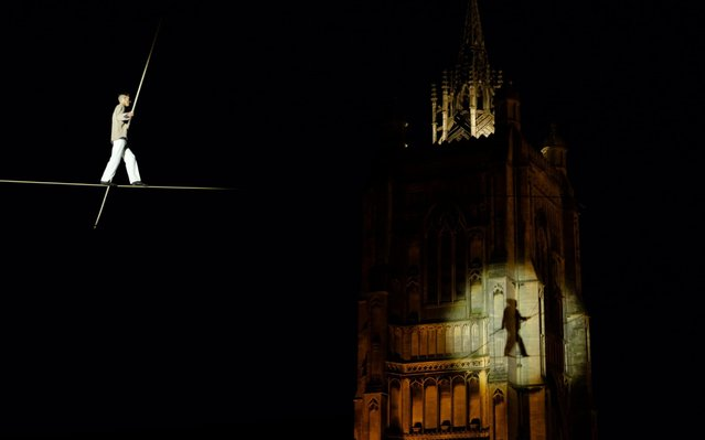 Death defying high-wire walk by Circus artist Chris Bullzini on a 230-metre long journey from Jarrold department store, across Norwich Market, with Sir Peter Mancroft Church in the background, to the top of the market accompanied by a live soundscape to launch the Norfolk & Norwich Festival 2019 on May 10, 2019 in Norwich, England. (Photo by Mark Bullimore/Getty Images)