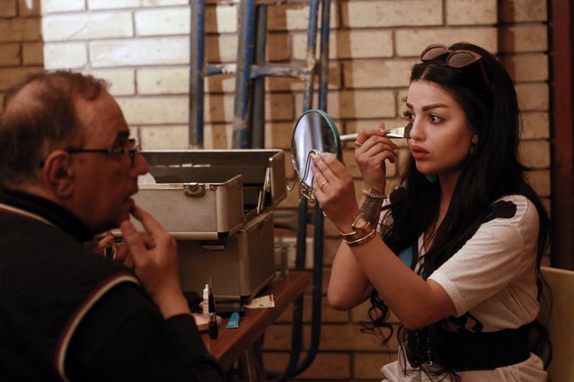 """In this Friday, April 26, 2019, photo, Iraqi actress Asrar al-Obeidi, right, prepares to perform her role in """"The Hotel"""", at a film set in Baghdad, Iraq. A Baghdad studio is filming Iraq's first TV drama in 7 years, as the arts come to life again in the capital after more than a decade of war. (Photo by Hadi Mizban/AP Photo)"""