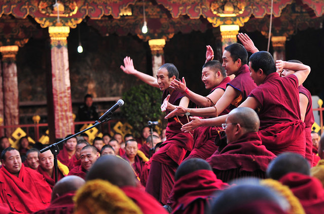 """Tibetan lamas take part in a ceremony to award """"Geshe Lharampa"""" degree, an academic degree for Tibetan Buddhism at Jokhang Temple, Lhasa, Tibet Autonomous Region, China, April 10, 2016. (Photo by Reuters/China Daily)"""