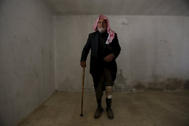 A man with an amputated leg poses for a photograph wearing his artificial limb in the rebel-controlled area of Maaret al-Numan town in Idlib province, Syria March 20, 2016. (Photo by Khalil Ashawi/Reuters)
