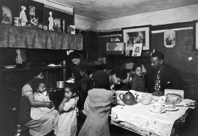 A West-Indian family in their dining room in the Gorbals district of Glasgow, Scotland, 31st January 1948. (Photo by Bert Hardy/Picture Post/Hulton Archive/Getty Images)