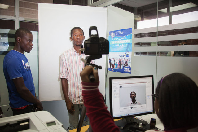 A Haitian has his photo taken at the Interior Ministry as he registers for legal residency in Santo Domingo, Dominican Republic, Tuesday, June 16, 2015. The Dominican Republic deported non-citizens for decades, mostly to neighboring Haiti. But it largely suspended deportations for the past year to allow people to register. (AP Photo/Tatiana Fernandez)
