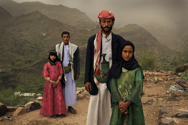 Tahani, 8, is seen with her husband Majed, 27, and her former classmate Ghada, 8, and her husband outside their home in Hajjah, Yemen, July 26, 2010. (Photo by Stephanie Sinclair/VII Photo Agency)