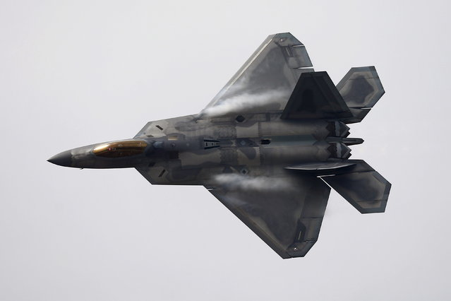 A U.S. Air Force F-22 Raptor fighter jet performs ahead of the International Air and Space Fair (FIDAE) at Santiago international airport, March 28, 2016. (Photo by Ivan Alvarado/Reuters)
