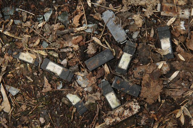 Small dosimeters that measure radiation dosage and used by emergency workers following the Chernobyl nuclear disaster lie scattered on the ground outside on April 9, 2016 in Pripyat, Ukraine. (Photo by Sean Gallup/Getty Images)