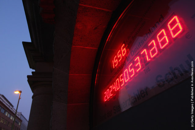 A debt meter, ostensibly showing the current level of the German national debt, reads over EUR 2 trillion over the entrance to the Federation Of Tax Payers in Berlin, Germany