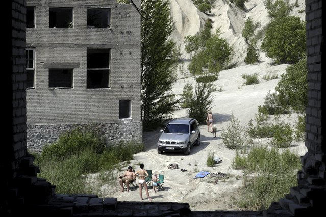 People sunbathe in Murru prison, an abandoned Soviet prison, during hot weather in Estonia July 4, 2015. (Photo by Ints Kalnins/Reuters)