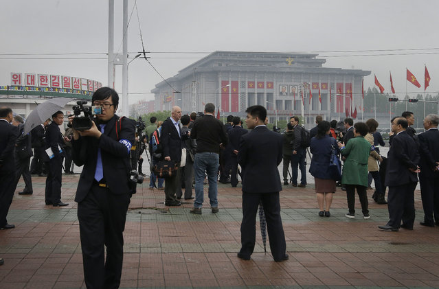 Foreign journalists are seen filming and reporting from across the April 25 House of Culture, the venue for the 7th Congress of the Workers' Party of Korea, on Friday, May 6, 2016, in Pyongyang, North Korea. (Photo by Wong Maye-E/AP Photo)