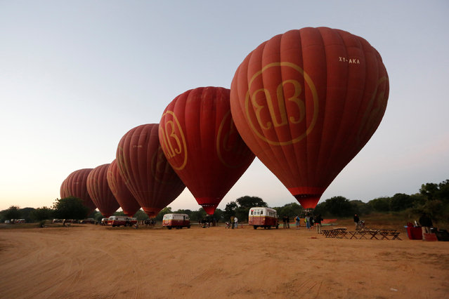Hot-air balloons carrying tourists take off before sunrise over ancient city Bagan January 11, 2017. (Photo by Soe Zeya Tun/Reuters)