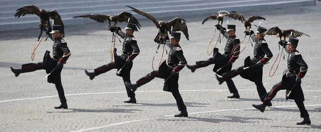 Falconers of the Mexican army hold falcons as they march during the traditional Bastille Day military parade on the Place de la Concorde in Paris, France, July 14, 2015. (Photo by Charles Platiau/Reuters)