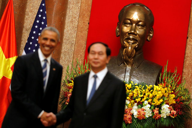 U.S. President Barack Obama shakes hands with Vietnam's President Tran Dai Quang after an arrival ceremony at the presidential palace in Hanoi, Vietnam May 23, 2016. (Photo by Carlos Barria/Reuters)