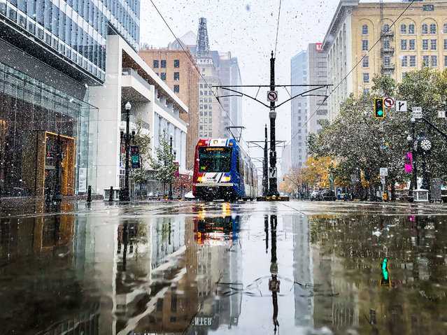 Snow falls in downtown Salt Lake City on Sunday, October 27, 2019. Meteorologists predict the first major snow of the 2019-20 season to hit the state Tuesday Oct. 29, 2019. Record-breaking cold temperatures are expected to continue throughout the week. (Photo by Carter Williams/KSL.com)