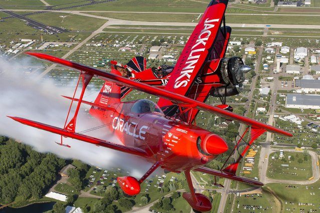 Renowned aerobatic pilots Sean D. Tucker, flying the Oracle Challenger III, and Jeff Boerboon, flying the Jack Link's Screamin' Sasquatch, take to the skies over EAA's 2015 AirVenture Oshkosh, on Monday, July 20, 2015 in Oshkosh, Wis. More than 500,000 people will attend the world's largest air show in Wisconsin this week. (Photo by Matt Ludtke/AP Images for Jack Link's)