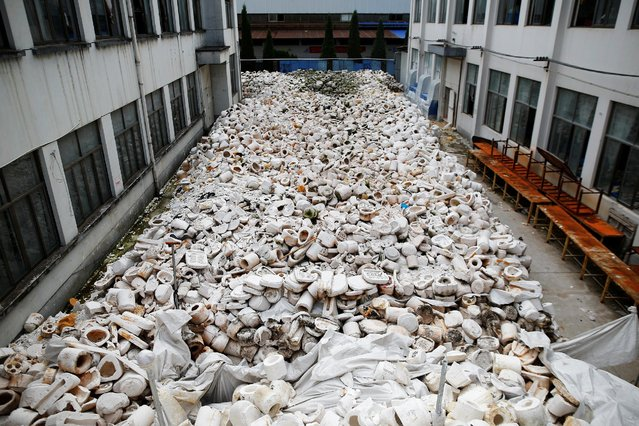 Used moulds are seen between buildings at Jinhua Partytime Latex Art and Crafts Factory in Jinhua, Zhejiang Province, China, May 25, 2016. (Photo by Aly Song/Reuters)