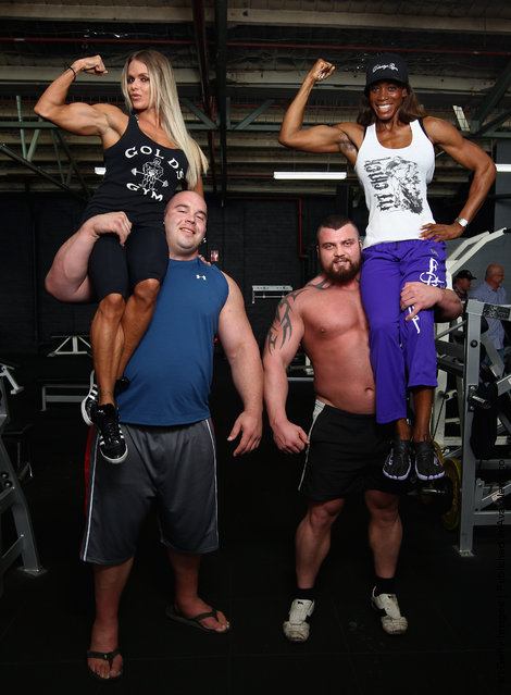 Strongmen Mike Jenkins and Ed Hall pose with female figure competitors Larissa Reis and Alicia Harris during a media call ahead of the 2012 IFBB Australian Pro Grand Prix XIII