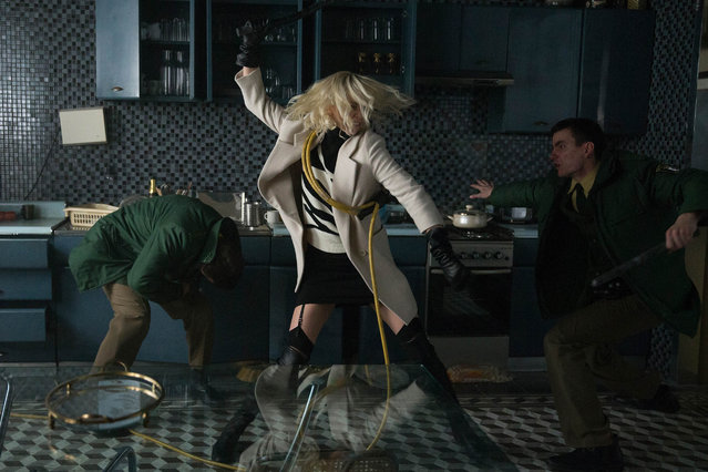 "Oscar winner Charlize Theron explodes into summer in ""Atomic Blonde"", a breakneck action-thriller that follows MI6's most lethal assassin through a ticking time bomb of a city simmering with revolution and double-crossing hives of traitors. (Photo by  Jonathan Prime)"