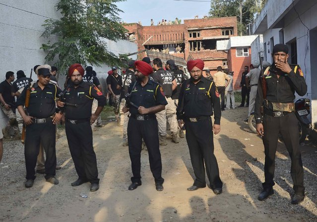 Indian security personnel stand at the site of a gunfight in Dinanagar town in Gurdaspur district of Punjab, India, July 27, 2015. (Photo by Mukesh Gupta/Reuters)