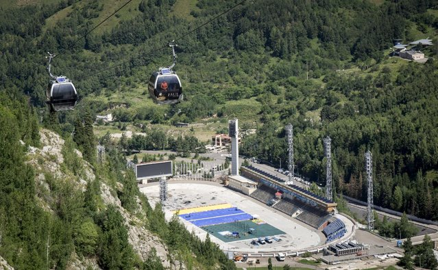 People travel in cable cars above the Medeu skating oval in Almaty, Kazakhstan, July 26, 2015. (Photo by Shamil Zhumatov/Reuters)