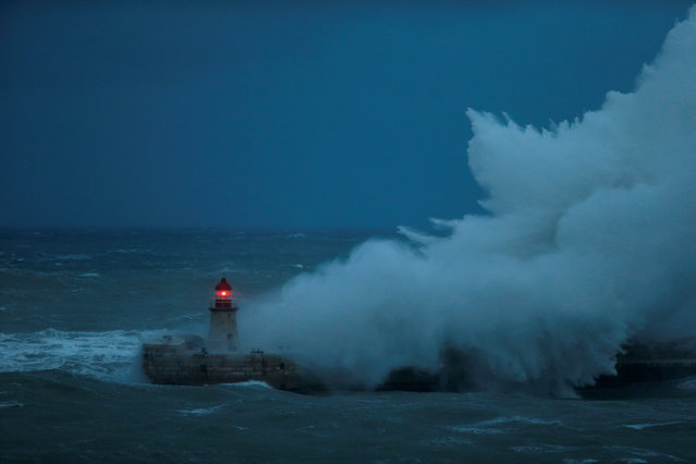 Waves crash over the breakwater at the entrance to Grand Harbour as gale force winds and rough seas lash the Maltese islands, in Valletta, Malta February 24, 2019. (Photo by Darrin Zammit Lupi/Reuters)