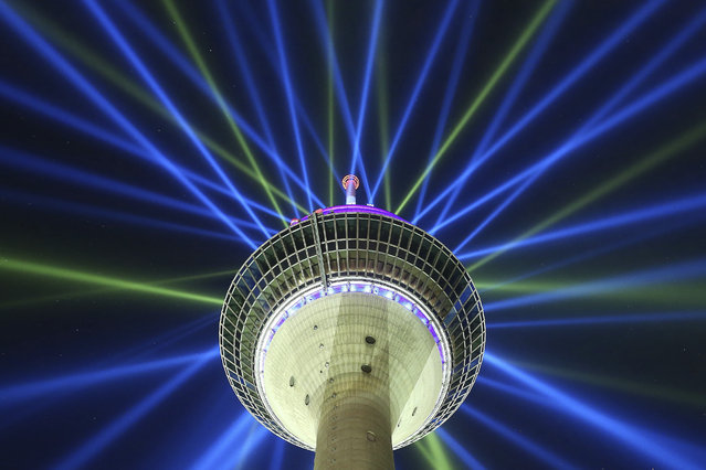 A June 26, 2017 photo shows of a light installation on the Rhine Tower during a rehearsal in Duesseldorf, Germany. The light installation promotes the start of the cycling race Tour de France  on Saturday July 1, 2017 in Duesseldorf. (Photo by David Young/DPA via AP Photo)