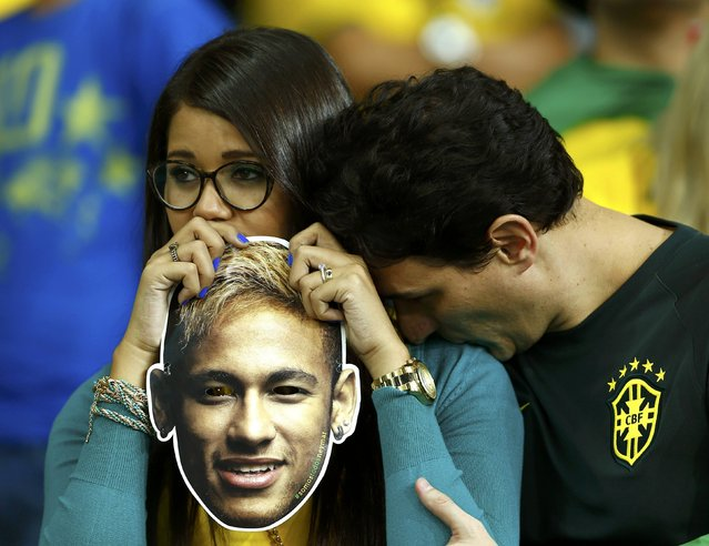 Brazil fans react while holding a mask of Neymar after the 2014 World Cup semi-finals between Brazil and Germany at the Mineirao stadium in Belo Horizonte July 8, 2014. (Photo by Eddie Keogh/Reuters)