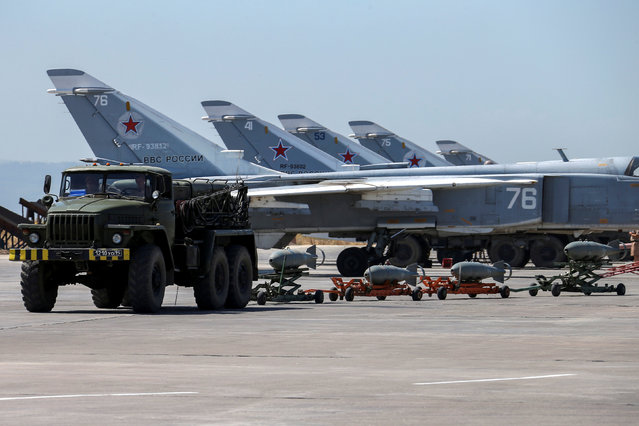 Russian military jets are seen at Hmeymim air base in Syria, June 18, 2016. Picture taken June 18, 2016. (Photo by Vadim Savitsky/Reuters/Russian Defense Ministry)