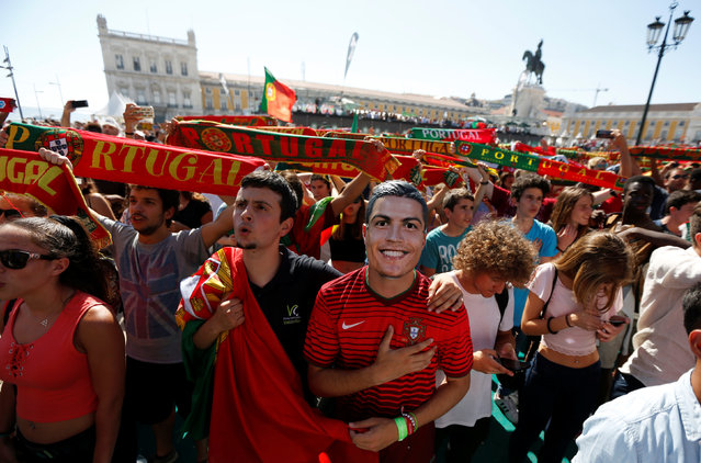 Fans of Portugal sing the Portuguese anthem before watching the Euro 2016 match between Portugal and Hungary at a public screening in downtown Lisbon, Portugal, June 22, 2016. (Photo by Rafael Marchante/Reuters)