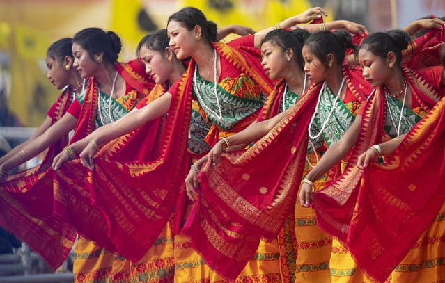 Indian Bodo tribal girls dance at an event to celebrate signing of a peace accord with the Bodo rebel group, National Democratic Front of Bodoland, in Kokrajhar, a town 250 kilometers (150 miles) west of Gauhati, India, Friday, February 7, 2020. Modi said on Friday that his government will continue its peace push in insurgency-wracked northeast bordering China and Myanmar where signing of accords with key rebel groups led to surrender by thousands of fighters. The prime minister said decades of violent insurrection ended in the Bodo tribal heartland in Assam state following the signing of the Jan. 27 agreement by the government with the rebel group. (Photo by Anupam Nath/AP Photo)