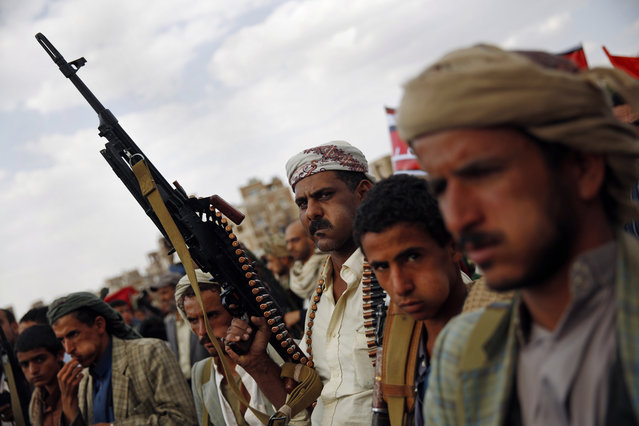 A Shiite Houthi rebel holds his weapon as he attends a rally to protest Saudi-led airstrikes, in Sanaa, Yemen, Monday, August 24, 2015. The Saudi-led coalition fighting Shiite rebels in Yemen doubled its near-daily airstrikes in the central province of Marib and the adjacent border area of Jawf on Monday, paving the way for allies on the ground to push north toward Shiite rebel strongholds, military and security officials said. (Photo by Hani Mohammed/AP Photo)