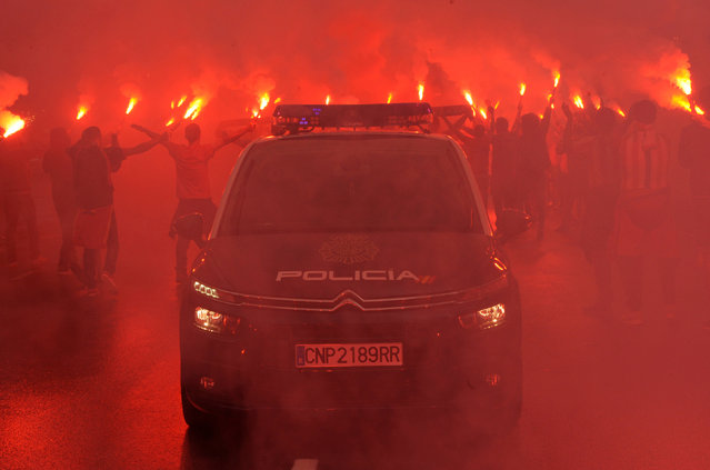 Sporting Gijon fans hold flares during clashes with police before the Sporting Gijon vs Real Oviedo Spanish second division football match in Gijon, northern Spain, September 9, 2017. (Photo by Eloy Alonso/Reuters)