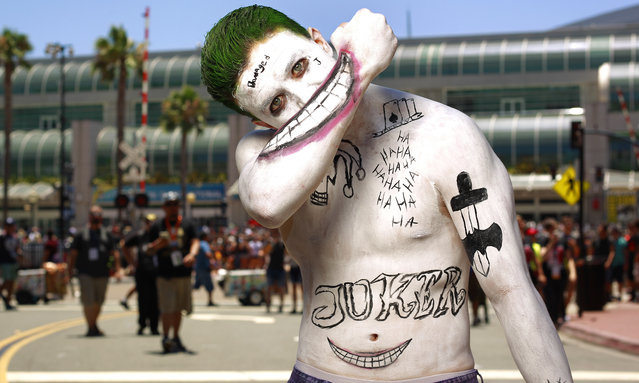 A Joker impersonator during opening day of the annual Comic-Con International in San Diego, California, United States July 21, 2016. (Photo by Rex Features/Shutterstock)