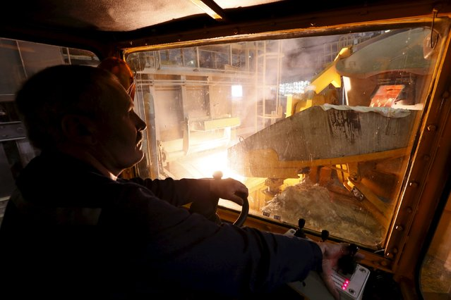 An employee operates a truck at a foundry shop of the Rusal Khakassia aluminium smelter outside the town of Sayanogorsk, Russia, September 3, 2015. (Photo by Ilya Naymushin/Reuters)