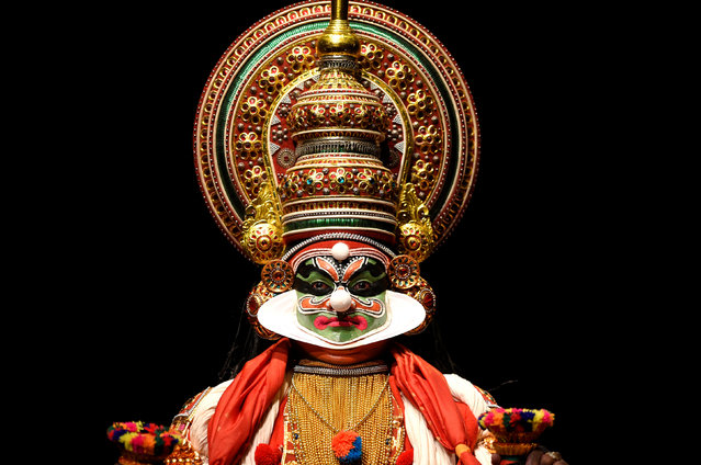 "A member of the Indian company Margi Kathakali theatre performs during ""Kijote Kathakali"", a Kathakali recital based on the Spanish classic ""Don Quixote"", at the Niemeyer Center in Aviles, northern Spain, July 29, 2016. The performance and text captured the essence of the novel while sticking to the format of Kathakali. Kathakali is one of the major forms of classical Indian dance. It is another ""story play"" genre of art, but one distinguished by its elaborately colorful make-up, costumes and face masks wearing actor-dancers, who have traditionally been all males. (Photo by Eloy Alonso/Reuters)"