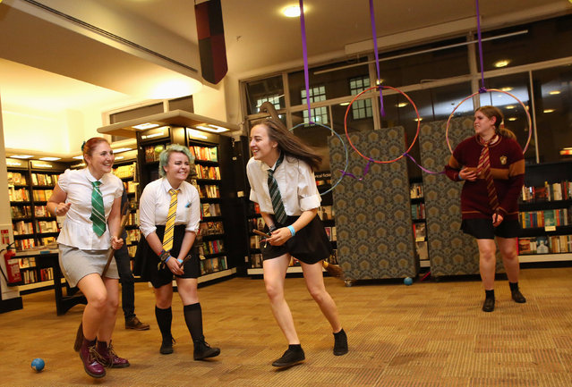 Fans play the fictional game of Qudditch at an event to mark the release of the book of the play of Harry Potter and the Cursed Child parts One and Two at a bookstore in London, Britain July 30, 2016. (Photo by Neil Hall/Reuters)
