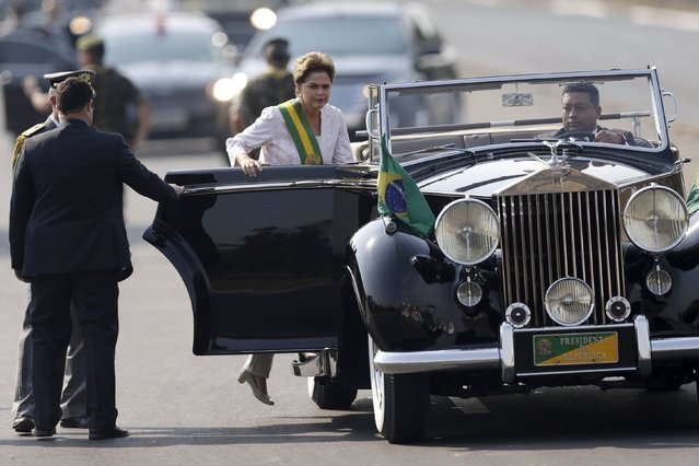 Brazil's President Dilma Rousseff gets into a vehicle during a civic-military parade to commemorate Brazil's Independence Day in Brasilia, Brazil September 7, 2015. (Photo by Ueslei Marcelino/Reuters)