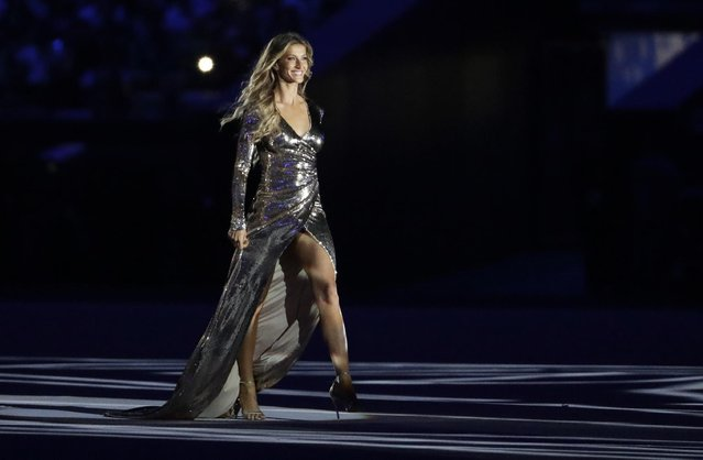 """Model Gisele Bundchen walks on stage as """"The Girl from Ipanema"""" during the opening ceremony for the 2016 Summer Olympics in Rio de Janeiro, Brazil, Friday, August 5, 2016. (Photo by David Goldman/AP Photo)"""