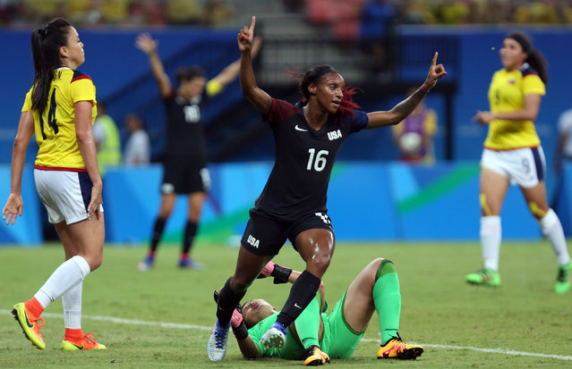 United States' Crystal Dunn, center, celebrates scoring her side's first goal during a group G match of the women's Olympic football tournament between Colombia and United States at the Arena Amazonia stadium in Manaus, Brazil, Tuesday, August 9, 2016. (Photo by Michael Dantas/AP Photo)