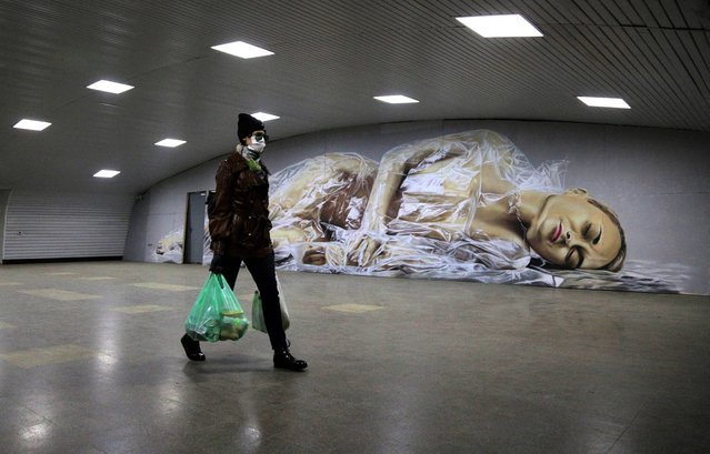A woman carries plastic bags with groceries in an underground passage. Russian President Vladimir Putin has expanded non-working period till April 30, 2020 to prevent the spread of the novel coronavirus. (Photo by Yevgeny Sofiychuk/TASS/Sipa USA)