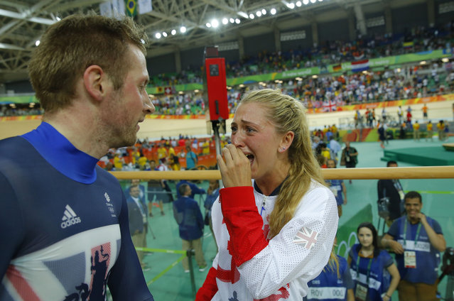 Britain's Laura Trott (R) reacts next to her fiance Britain's Jason Kenny after he won the Men's Keirin finals track cycling event at the Velodrome during the Rio 2016 Olympic Games in Rio de Janeiro on August 16, 2016. (Photo by Odd Andersen/AFP Photo)