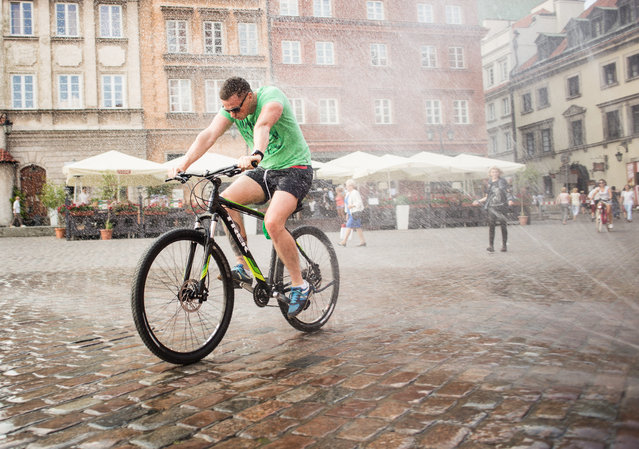 7: Warsaw, Poland. Latest ranking: 65; Ranking five years ago: 71; Five-year index movement: 2.1%. Here: A cyclist cools off on a hot day in the Polish capital. (Photo by NurPhoto via Getty Images)