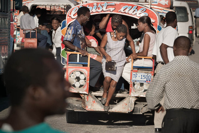 Port-au-Prince, Haiti.Taptap, group bus, stop at the airport crossroads in Delmas in November 2003. (Photo by Jean-Claude Coutausse)