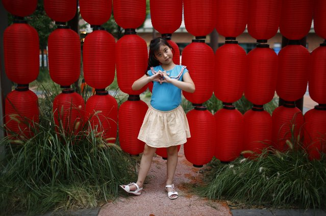 "Liang Xiao, who was born in 2007, poses for a photograph in Shanghai August 24, 2014. ""I want a little sister because little brothers are naughty"", Xiao said. (Photo by Carlos Barria/Reuters)"