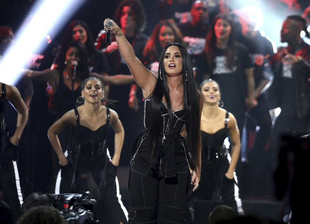"""Demi Lovato performs """"Sorry Not Sorry"""" at the American Music Awards at the Microsoft Theater on Sunday, November 19, 2017, in Los Angeles. (Photo by Matt Sayles/Invision/AP Photo)"""