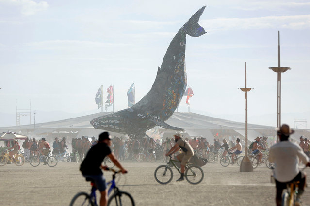 Participants gather around The Space Whale art installation as approximately 70,000 people from all over the world gather for the 30th annual Burning Man arts and music festival in the Black Rock Desert of Nevada, U.S. August 29, 2016. (Photo by Jim Urquhart/Reuters)