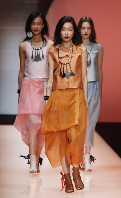 Models wear creations for Emporio Armani women's spring-summer 2016 collection, part of the Milan Fashion Week, unveiled in Milan, Italy, Friday, September 25, 2015. (Photo by Luca Bruno/AP Photo)