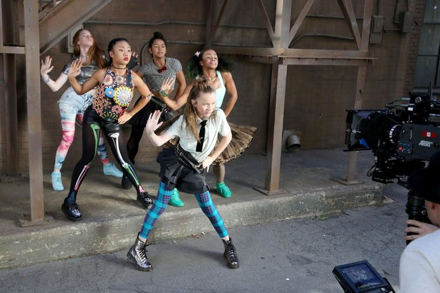 In this image distributed on Tuesday, September 29, 2015, 11-year old dance star Taylor Hatala and friends are seen filming their new Monster High Boo York, Boo York music video #CityGhouls in Los Angeles. (Photo by Casey Rodgers/Invision for Mattel/AP Images)