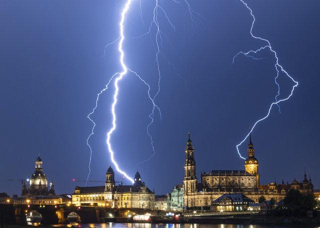 Lightning strikes across the sky in Dresden, Germany, Monday, June 10, 2019. (Photo by Robert Michael/dpa via AP Photo)