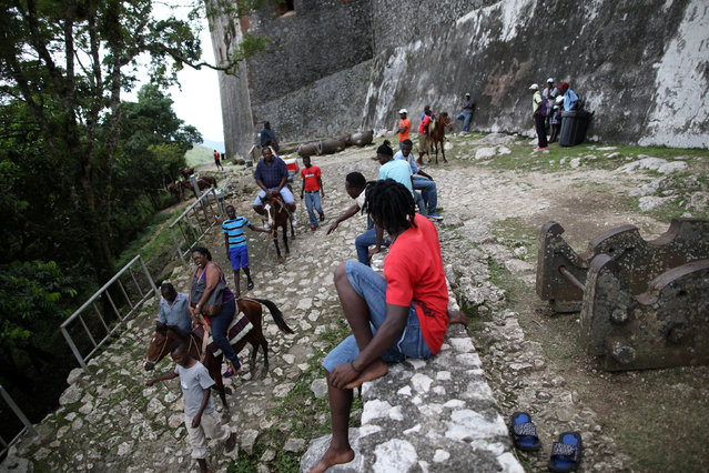 American tourists Janet Moore and Leonard Moore ride horses on their way down from the Citadel Laferriere in Milot, Haiti, November 19, 2017. The Citadel Laferriere is one of the main touristic attractions in Haiti and it is considered a World Heritage Site according to United Nations Educational, Scientific and Cultural Organization (UNESCO). (Photo by Andres Martinez Casares/Reuters)