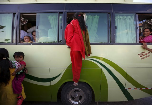 A passenger (C) climbs through the window of an overcrowded bus as limited public transportation operates in the city during the ongoing fuel crisis in Kathmandu, Nepal October 9, 2015. Nepal is considering air-lifting fuel, possibly from Bangladesh, as supply routes from India stay blocked by protesters opposing its new constitution, a short-term solution ahead of a key festival even as the government talks to China for help. (Photo by Navesh Chitrakar/Reuters)