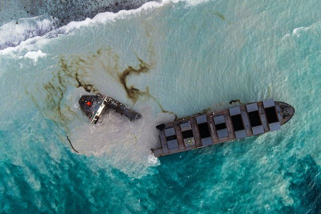 This aerial picture taken on August 16, 2020, shows the MV Wakashio bulk carrier that had run aground and broke into two parts near Blue Bay Marine Park, Mauritius. A ship that has leaked more than 1,000 tonnes of oil in pristine waters off the Mauritius coast has split into two, its Japanese operator said August 16, 2020. (Photo by AFP Photo/Stringer)